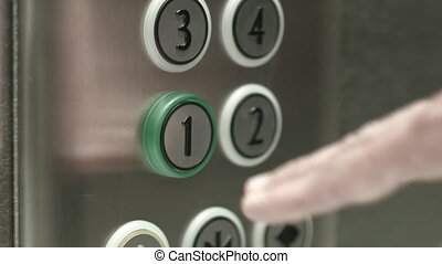Man presses a button the first floor in an elevator - Man...