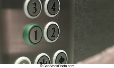 Man presses a button the second floor in an elevator - Man...