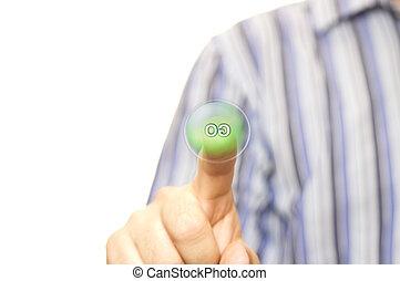 Man presses a green GO button