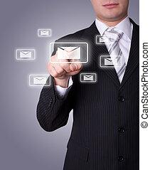 Man pressing e-mail icon