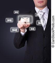 Man pressing e-mail icon - Man hand pressing e-mail icon