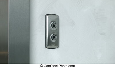 Man pressing elevator button to go down. Close up