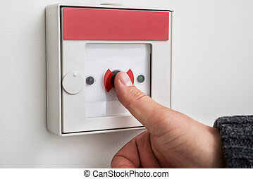 Close-up Of A Person's Hand Pressing Emergency Alarm Button