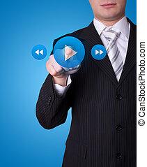 Man pressing media player button