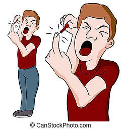 Man Pricking His Finger - An image of a man pricking his...