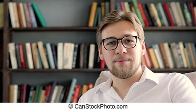 Man professor or student in glasses at University library ...