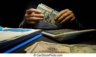 Man proposes money. Manager sits in the office and give...