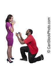 Man with a wedding ring proposing marriage to a woman