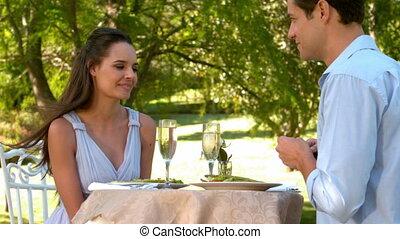 Man proposing marriage to his shoc