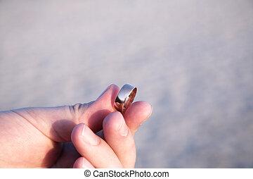 Man proposing on the beach