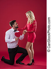Man proposing to his beloved woman