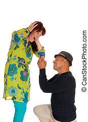 Man proposing to his girlfriend.
