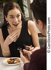 Man proposing to woman. - Mid adult Caucasian man proposing...