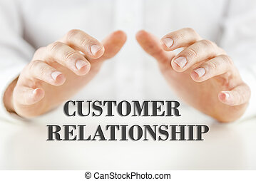 Man protecting the words - Customer Relationship - with his...