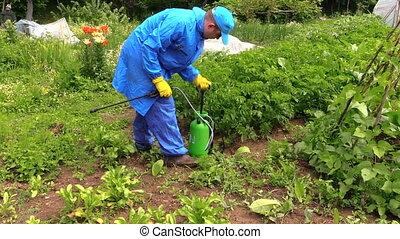 man pump sprinkler tool - Peasant farmer man pump sprinkler...
