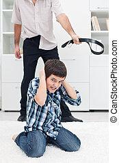 Man punishing his son