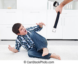 Man punishing his son