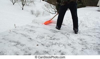 man push snow roof winter