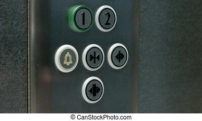 Man pushes a button closing elevator doors. Close up - A man...