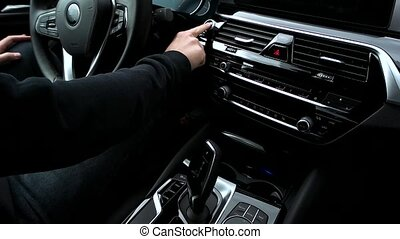 Man pushes start button in car