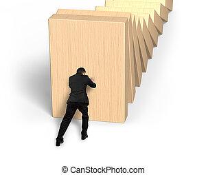Man pushing and stopping dominoes falling