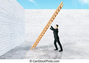 Man pushing ladder to wall