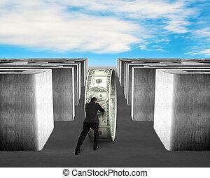 Man pushing money circle through 3d Maze