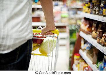 Man pushing shopping trolley
