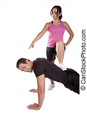 man pushups bossy woman - A woman is pointing and making the...