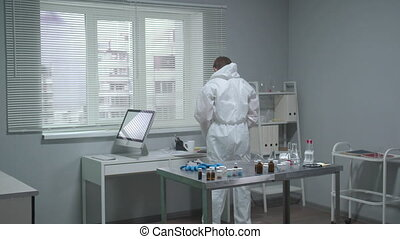 Man put on protective workwear in the laboratory - Man put ...