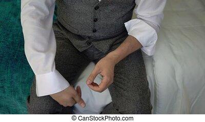Man put on shirt - Man put on and buttoning white shirt