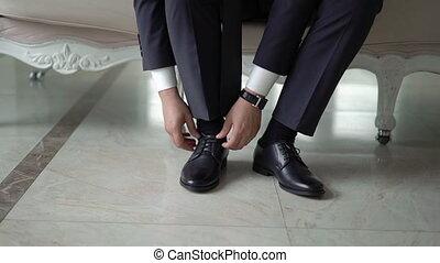Man put on shoes - Man put on black shoes