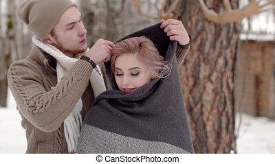 man put on woman shawl