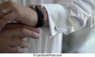 Man put on wrist watches closeup
