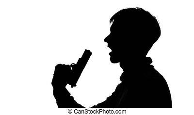 Man puts a gun to him mouth. Silhouette. White