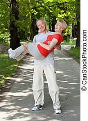 Man puts his wife in his arms