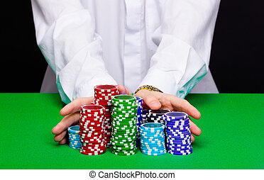 Man puts in the casino. Hand with chips