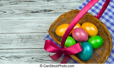 Man puts on a table the Easter basket with Decorated and...