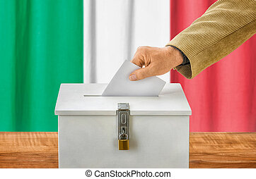 Man putting a ballot into a voting box - Italy