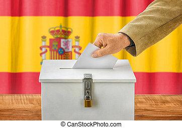 Man putting a ballot into a voting box - Spain