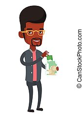 Man putting dollar money into glass jar.