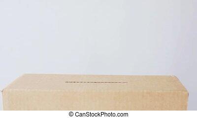 man putting euro money into donation box - charity,...