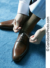 Man putting on shoes for work - Man putting on brown leather...
