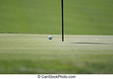 Man putting on the golf green