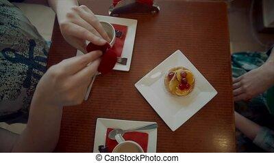 Man Putting Ring on Girl's Finger in cafe