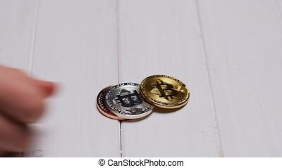 Man putting several bitcoins
