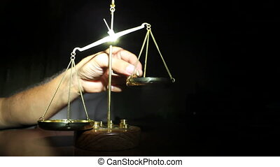 Man Putting Weight on Golden Balance Scales Standing On...