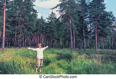 Man Raised Arms in Forest