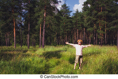 Man Raised Arms in Summer Forest