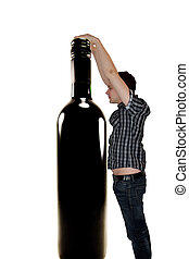Man reaching for wine bottle - Picture of a man reaching for...
